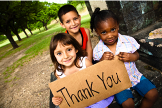 photo of children holding a thank you sign